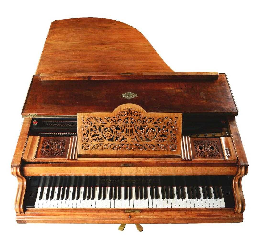 Overhead view of an old Schweinhofer piano with a florid decorative music stand