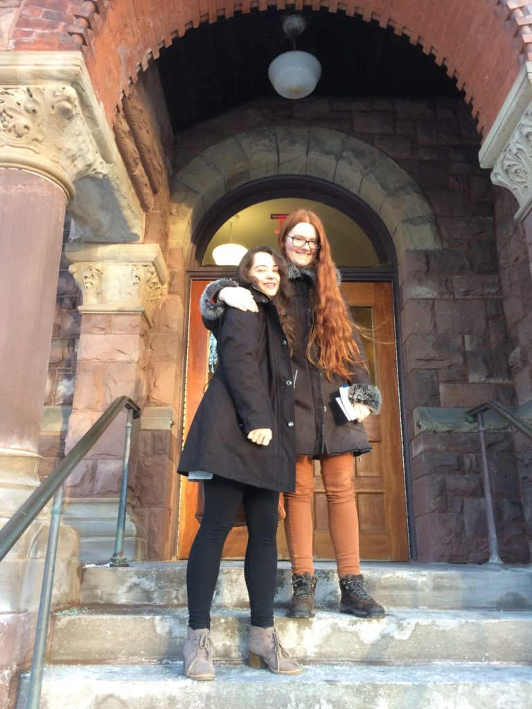 Nina Knight and Ellie Cherry outside of Lincoln Hall, home of the Department of Music