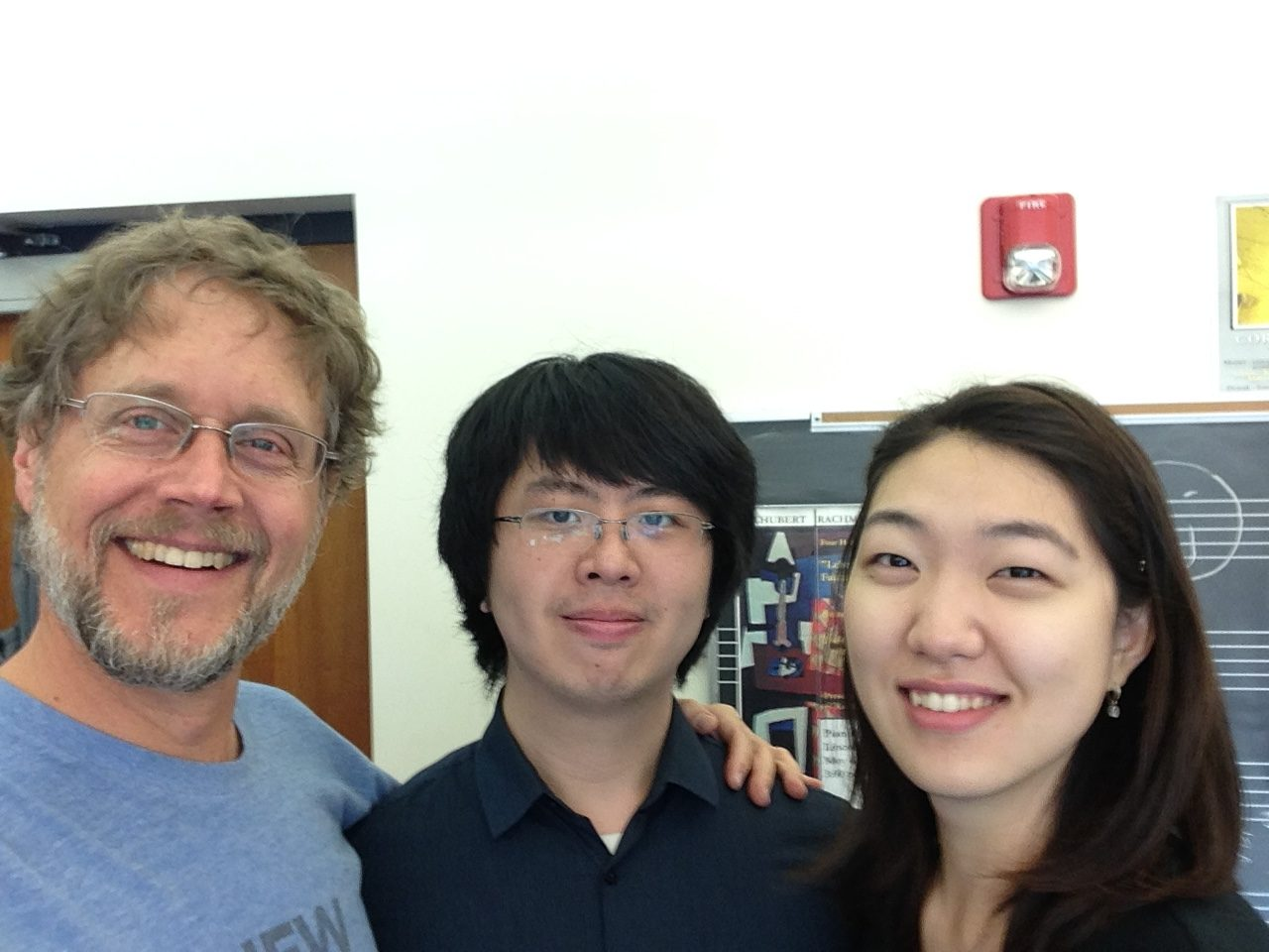 Photo of Xak Bjerken with former students Fred Dong and Kyuree Kang